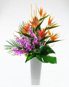 Pretty please by teleflora perfect for a birthday celebration or impressive high style design using birds of paradise orchids tropical foliage with bamboo accents mightylinksfo