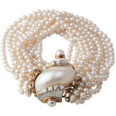 SEAMAN SCHEPPS 18K, Pearl & Diamond Turbo Shell Bracelet at 1stdibs ❤ liked on Polyvore