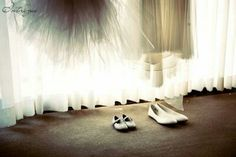 Photo of bride and flower girl dress and shoes #intriguephotography #weddingphotography