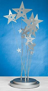 Create a star scene with this Celestial Wonders Centerpiece. The metal 16 inch high x 6 inch diameter centerpiece features several stars. yellow stars instead? Dance Themes, Prom Themes, Starry Night Prom, Starry Nights, Night To Shine, Dress Up Storage, Mesas Para Baby Shower, Party Table Centerpieces, Samba