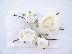 Ranunculi hairpins by Loveflowers. Fascinator by Loveflowers. Find your perfect wedding flowers at http://www.loveflowers.com.au/