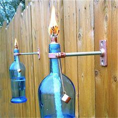 Wine bottle tiki torch. Love blue glass!