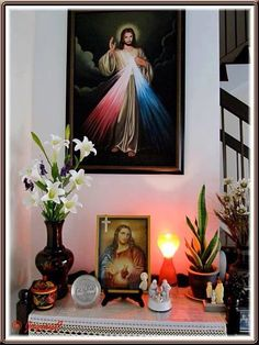 Catholic home altar with Divine Mercy, candles, statues, and flowers Divine Mercy, Home Altar Catholic, Catholic Prayers, Personal Altar, Altar Design, Prayer Corner, Altar Decorations, Home Icon, Family Rooms