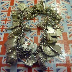 Vintage Sterling Silver Charm Bracelet 36 Charms,Rare Opening Charms too - 1 only via Etsy