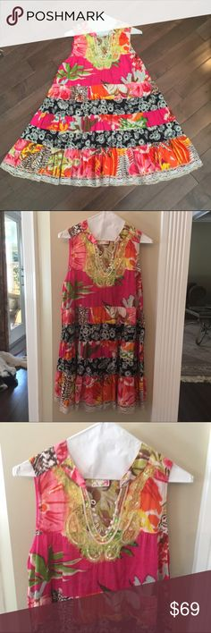 Free People Dress Sz. S/P How Beautiful is this dress! Perfect for your summer wardrobe. The colors are so bright and vibrant! Very lightweight. It is a size SP. shell: 100% cotton. Excellent like new condition. Free People Dresses Midi