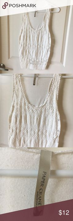 White lace tank top White lace floral tank top. Brand is Paper Crane. You cannot see the size anymore but it should be a small or a medium. I offer discounts for bundles and welcome offers :) Paper Crane Tops Tank Tops