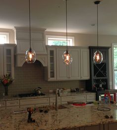 Three of our bubble pendants hung in one of our awesome customer's new kitchen! hammersheels.com Hand Blown Glass, Glass Shades, New Kitchen, Glass Pendants, Organic Glass, Glass, Bubble Lights, Blown Glass Pendant, Glass Lighting