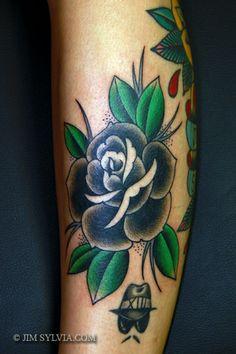 traditional black memorial rose tattoo