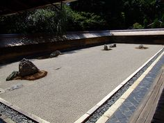 Kyoto - Ryoan-ji Temple is famous for its mysterious rock garden, the most celebrated in Japan, which defies attempts at explanation. Enclosed by an earthen wall, fifteen carefully placed rocks seem to drift in a sea of raked white gravel. A viewing platform right above the garden gives visitors an unimpeded view, although from whatever angle you view the garden, you can never see all fifteen stones