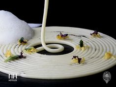 Olive oil spaghetti by @Luz Trejo Roncero . He uses an emulsion of extra virgin olive oil with methylcellulose to create a cream which is injected into the hot soup using a syringe to form perfect spaghetti.
