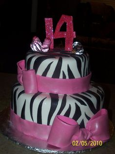 Teen Girl Cakes | zebra print with pink fondant bows.
