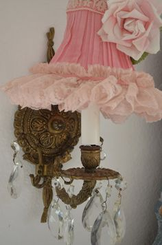 what a pretty way to adorn a light sconce...