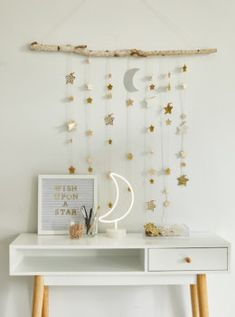 Create a DIY star wall hanging using a tree branch, twine, and paper stars. Add glitter or wrapping paper for dreamy room decor. Ramadan Crafts, Ramadan Decorations, Ramadan For Kids, Branch Decor, Diy Tassel, Macrame Plant Hangers, Star Wall, Paper Stars, Diy Wall Decor