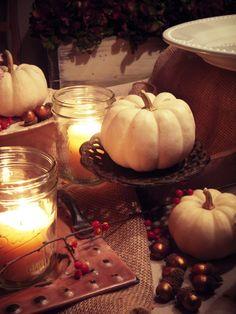 White pumpkins and mason jar candles