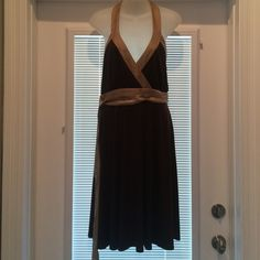 NWT BCBG PARIS Halter Wrap Tie Dress Size 8 This is an absolutely stunning and fun dress. This is an easy wear dress with a base color of expresso and a flirty contrasting gold trim. This is new with a tag and extra buttons for the neck. As always my items are from a smoke free home and ship immediately! BCBG Dresses Backless