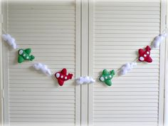 Airplanes and clouds bunting/ banner/ garland - Plum red and apple green felt airplanes, white felt clouds - custom made. $67.00, via Etsy.