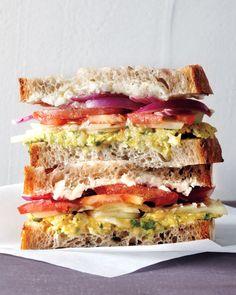 Greek Salad Sandwich with Chickpeas, Red Onion, Feta, Cucumber, Tomato & Fresh Parsley on Rustic Bread.