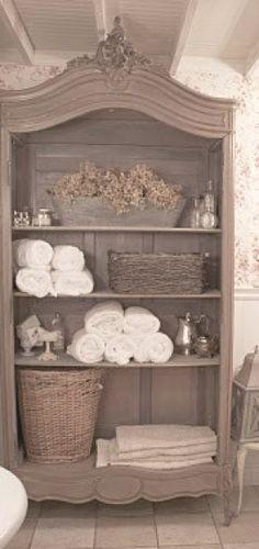 Try a wood shelf as a bathroom towel closet.   Find one here...