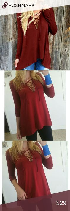 Red Hooded Lace Up Top New with tags Red flowy lace up/tie long sleeve top Has a hood Light weight True to size  PRICE IS FIRM Tops Blouses