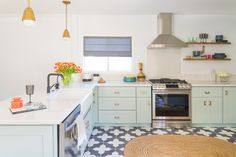 The color of the cabinets is mint, there are cute brass touches and mosaic tile floors