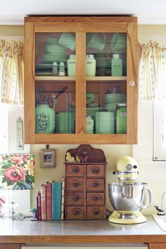 "Location: Wethersfield Meet the reader: Sharon DiGioia-Daskal  Spice world: ""Our 1780s Colonial is filled with pieces that represent who we are and what we like—for instance, the spice cabinet that was my mother's, and my jadeite collection above it."""