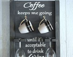 How To Tell Time Coffee/Wine Glass Holder  DUE TO THE HIGH DEMAND THE SHIPPING SCHEDULE MAY BE UP TO 4 WEEKS.  Size is approximately 18 in x 16 in. Dark stain with white painted letters. Sawtooth hangers attached to back so its ready to hang when you receive it. Coffee Cups and Wine Glasses not included.