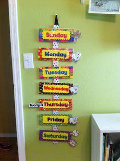 "Toddler Weekly Calendar. Glued ribbon on a yard stick, used Velcro to attach the days of the week. Printed out clip art of activities of the week, ie school, church, t-ball, birthdays, holidays, etc. Glued them to clothes pins that can be interchanged. Also included a ""Today is"" clip that my son can move everyday. Great way to teach the days of the week, and no more 100 questions about when his t-ball game is, I tell him to look at his calendar!!"