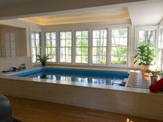 """The woodland view, tray ceiling with recessed lighting, and """"pickled"""" white-wood finishing make this Endless Pool installation clean and serene. Indoor Pools, Small Indoor Pool, Small Backyard Pools, Small Pools, Outdoor Pool, Lap Pools, Pool Decks, Pool Images, Pool Picture"""