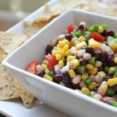 can black eyed peas 1 can black beans 1 can shoepeg corn 1 jar pimentos 1 jar pepper rings (banana peppers) chopped 1 small red onion 2 stalks chopped celery 1 cup olive oil 1/2 cup apple cider vinegar 1/2 cup sugar Frito scoops  Pour all cans/jars ingredients into colander and rinse Put rinsed ingredients in a container with a lid Add onion and celery Heat olive oil, vinegar and sugar until sugar dissolves Pour mixture over ingredients and marinade overnight Drain and serve with chips