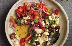An olive-oil vinaigrette flavours this simple salad of tomatoes and onions.