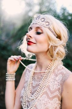 """Easy, Cheap DIY Halloween Costume: Daisy Buchanan from """"The Great Gatsby.""""  Tease and curl your hair. Fold it under a bold headband. Choose a muted-colored dress- the lacier, the better! And pile on as many pearls as possible. With sparkly bracelets, bold lips, and some false lashes, you're ready for, """"Gatsby? What Gatsby?"""""""