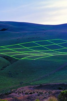 Luminous Earth Grid is an outdoor art installation by Stuart Williams which is an array of 1,680 energy-efficient fluorescent lamps, swept over an area equal to 8 football fields.    Tumblr