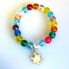 Just Cause? Autism Awareness Bracelet Just Cause Stretched Designs. $6.98. One Bracelet. Stretch Bracelet Design. Multi-Colored Glass Beads. Great gift idea to show your support and spread awareness for Autism. Ribbon Charm