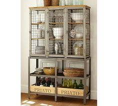 "Gridley Caged Storage Cabinet #potterybarn   Modeled on the caged lockers once used in factories and gymnasiums, this cabinet has a bold, industrial appeal.  49.25"" wide x 17"" deep x 77.25"" high  Crafted with a steel frame, mahogany shelves and wire-mesh panels.  Three doors open to nine fixed shelves; doors lock with drop-down latches.  Includes four spacious bottom shelves.  $1400"