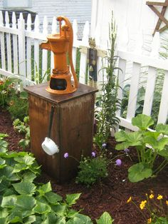 pump from an auction sitting atop reclaimed wood base hubby made. Well Pump Cover, Rustic Bird Baths, Septic Tank Covers, Hand Pump Well, Old Water Pumps, Diy Garden Fountains, Outdoor Projects, Outdoor Decor, Ponds Backyard