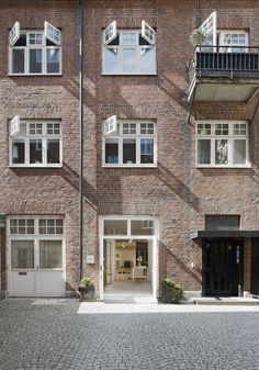 brick facade + architecture + white window framing