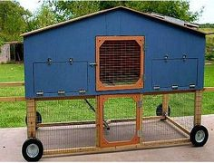 Roll-able chicken-coop with outdoor section below.