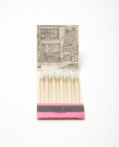 Checks Cashed by the Taj Mahal  by Krista Charles -- With the series Matchbook Landscapes, I have combined my love of art, travel, and secondhand shopping through peoples collections of matchbooks. For each matchbook, I find the location of the business in Google Maps. On the inside cover of the matchbook, I make a pencil sketch of whatever is there now