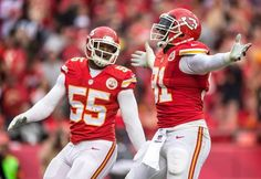 Kansas City Chiefs outside linebacker Tamba Hali (91) celebrated his fourth quarter sack of Oakland Raiders quarterback Derek Carr with teammate Dee Ford (55) during NFL action on December 14, 2014 at Arrowhead Stadium in Kansas City, Mo.