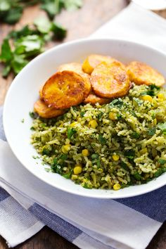 This Green Mexican Rice with Corn is made with spinach, jalapeno, garlic, and cilantro, and it goes perfectly with anything! 240 calories.
