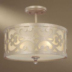 Free Shipping. Comes in Nanti Champagne Silver Finish with Etched Vanilla Glass Shade. Nanti is an exciting collection of transitional pendants and sconces. Playful traditional motifs are paired with Minka's beautiful, warm Etched Vanilla glass. Takes 3 60-watt Medium bulbs.