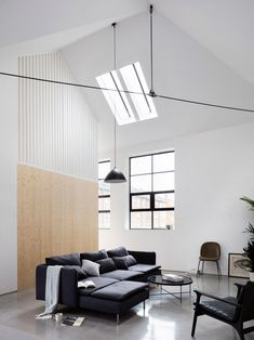 The founder of east London architecture studio Paper House Project has transformed a former warehouse in Hackney into a two-bedroom house featuring a double-height living space and nods to its industrial heritage.