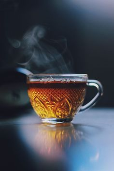 Stunning shot of hot tea on a reflective surface