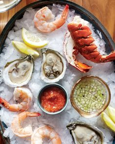 """Fabulous French Appetizer Recipes That Bring the Bistro Home - """"Fruits de mer"""" is the French term for seafood, it literally means """"fruits of the sea."""" Present a bounteous harvest of shrimp, oysters, and lobster tails with simple homemade sauces on a bed of crushed ice for a spectacular start to the meal."""