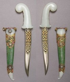 Indian khanjar dagger, 19th century, steel, nephrite, gold, emeralds, rubies, diamonds, ray skin, H. with sheath 15 11/16 in. (39.8 cm); H. without sheath 14 5/8 in. (37.1 cm); W. 3 3/8 in. (8.6 cm); Wt. 15.8 oz. (447.9 g); Wt. of sheath 1.8 oz. (51 g), Met Museum.
