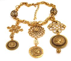 Oscar de la Renta Coin-Portrait Medallion Necklace  This new without tags necklace is superb. It measures 26″ around the neck with a 4″ extender. The coin bib part drops 5″ long.