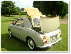 Nissan figaro!  The most beautiful car ever!