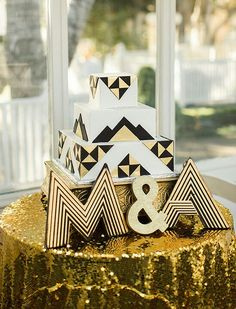 Great Gatsby inspired wedding cake black and gold