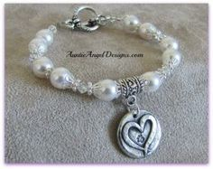 Forever Paws:  The Bracelet, by Auntie Angel Designs.  Celebrating the pure unconditional love of our furry friends and family members.  When they leave this earth, they leave paw prints on our hearts.  This classy and sparkly piece is made with genuine Swarovski pearls and crystal beads, with handmade silver artisan heart charm with tiny paw print stamped within.  A steal at just $45.00.  Includes shipping within the U.S. (only).