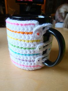 Coffee Mug Cozy.  This pattern is not for a loom, but it looks simple enough to make on a loom.